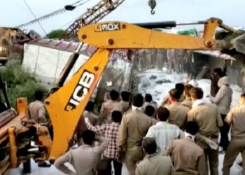 A police rescue team work to lift a truck afterat the site of an accident where a truck carrying migrant labourers collided with another, killing and injuring several people in Auraiya, Uttar Pradesh, India, May 16, 2020 in this still image taken from video. ANI via REUTERS  TV THIS IMAGE HAS BEEN SUPPLIED BY A THIRD PARTY. INDIA OUT. NO COMMERCIAL OR EDITORIAL SALES IN INDIA